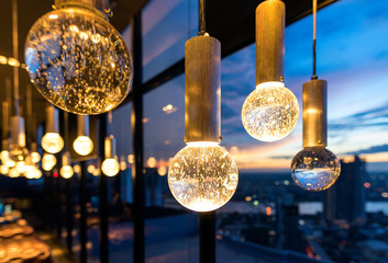 Luxury interiors of Chandelier Light pattern background at modern building.Selective focus with shallow depth of field.