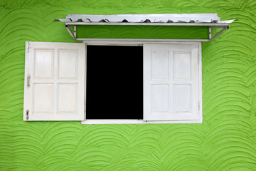 White window on bright green wall.
