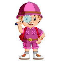cute hiker boy holding magnifier