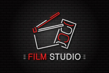 Vector isolated neon sign of cinema equipment for decoration on the wall background. Realistic neon logo for film studio. Concept of cinema, director profession and movie production.