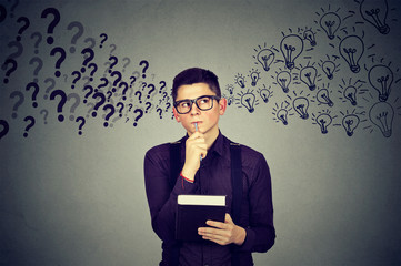 Young man finding answers to many questions generating ideas
