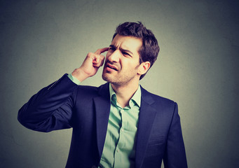 Confused business man thinking scratching his head