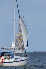 SAILING - Small boat and big sailing ship