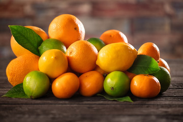 organic juicy citrus fruits on the rustic table.
