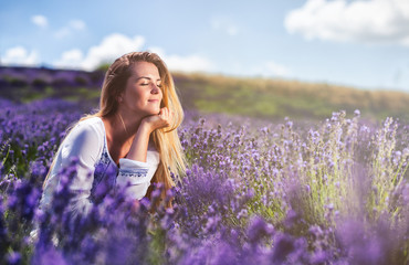 Lovely cute woman in lavender field at sunny day freedom concept