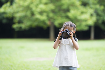 Happy Little Girl taking pictures