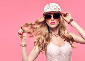 Fashion Model Sexy Girl Portrait. Hipster woman Cheeky emotion. Stylish Summer Outfit. Crazy Blond in Fashion Sunglasses, Trendy fashion Cap. Glamour Wavy Hairstyle. Playful Summer Mood Wall mural