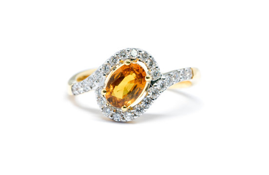 beautiful Gold ring with diamond and yellow sapphire isolated