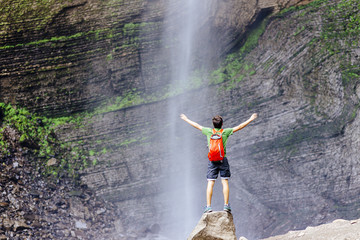 Tourist stands close in the Front of  the Gocta waterfall in nothern peru