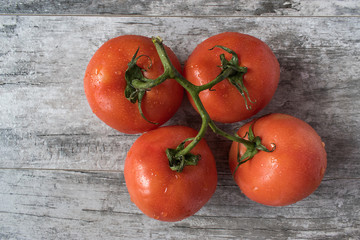top view Isolated Tomatos on vine on gray table