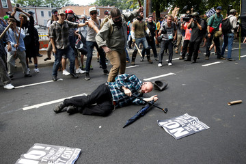 A man is down during a clash between members of white nationalist protesters and a group of counter-protesters in Charlottesville