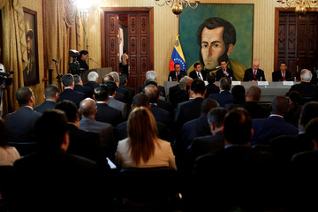 Venezuela's Foreign Minister Jorge Arreaza delivers a speech in front of a paint of Venezuela's national hero Simon Bolivar, during a meeting of accredited diplomatic teams in Caracas