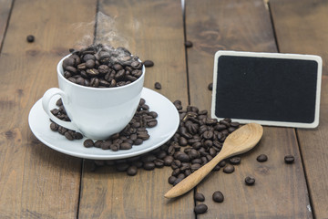 coffee beans in a coffee cup on a wooden floor