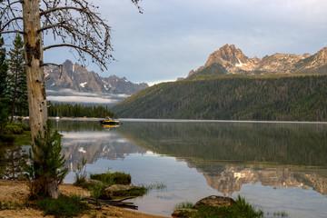 Yellow boat sets on an Idaho mountain lake