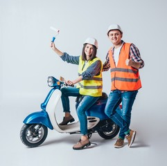 Photo sur Toile Motocyclette Happy young couple on motorbike. Shopping for the construction and repair of a new home .