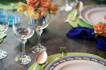Dining table decoration with flowers and lots of color