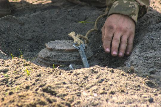 Anti-tank mine installing