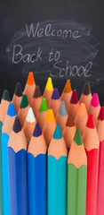 back to school pencils border on blackboard with welcome back o school text