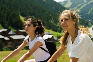 Women riding bikes in countryside
