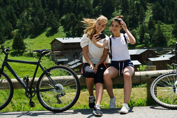 Women with bikes taking a selfie