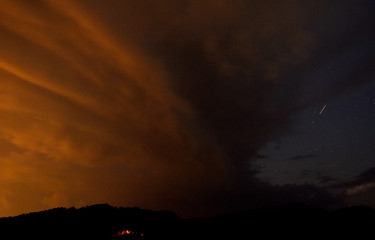 A meteor streaks past stars in cloudy night sky during the annual Perseid meteor shower, near Skopje, Macedonia
