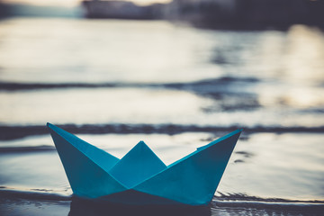 Blue lonely paper boat