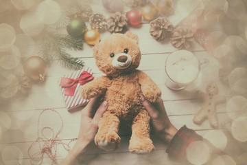 female hand holding a teddy bear