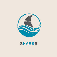 icon of angry shark fin with sea waves