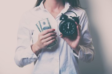 young woman with clock and money