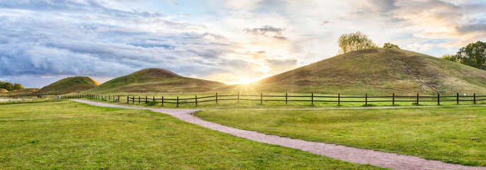 Panorama of Royal Mounds on sunset in Gamla Uppsala, Uppland, Sweden