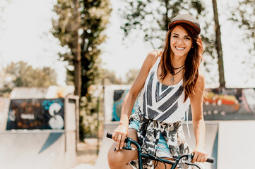 Urban woman sitting on her bike.