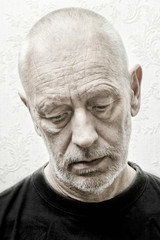 Black and white portrait of a sad and depressed caucasian man with eyes looking down