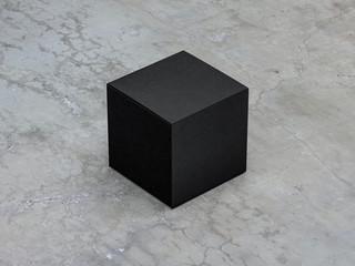 Square Black Box for cosmetics on concrete floor. 3d rendering