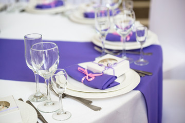 Restaurant banquet hall with served decorated wedding tables
