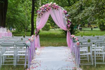 Pink wedding altar arch decoration in the garden