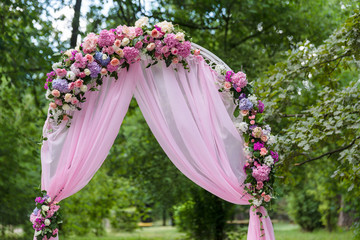Pink wedding altar arch decoration in the garden