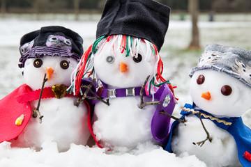 Three trendy snowmen dressed beautifully