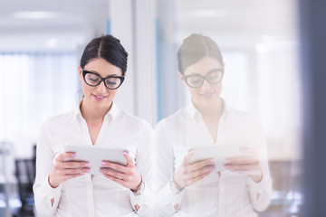 Business Woman Using Digital Tablet in front of startup Office