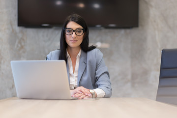 businesswoman using a laptop in startup office