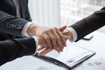 Close Up 3 businessmen Join Hands Support Together Concept