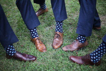 Groom and Groomsmen showing off their Blue socks with polka dots