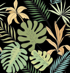 Palm leaves on a black background. Tropical print. Seamless pattern.