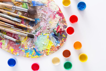 Art palette with colorful paint strokes, isolated