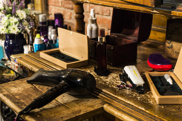 Hairdressing tools on a vintage table