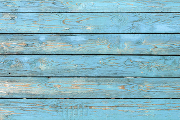 Vintage wooden boards of blue color as background