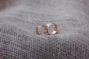 Wedding rings on sackcloth. Rustic style, decoration, wedding background