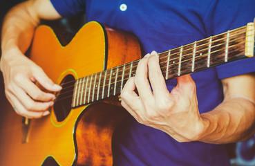 musician man playing picking acoustic guitar.