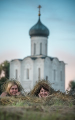 two young women lie in the Seine amid Russian church