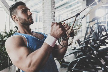 Calm man working out in keep-fit studio
