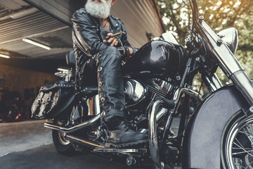 Old bearded locating on motorbike